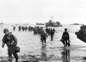 American assault troops move onto a beachhead during the D-Day invasion of German-occupied France on the beach of Normandy, June 7, 1944  during World War II.  The harbor is filled with numerous other landing craft awaiting orders.  (AP Photo)